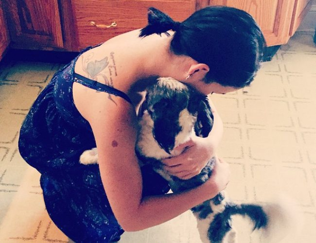 woman-hugging-dog-in-kitchen